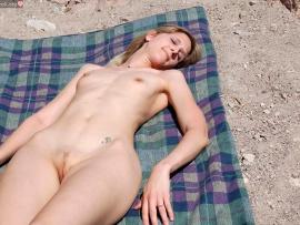 naturalist-woman-sunbathing