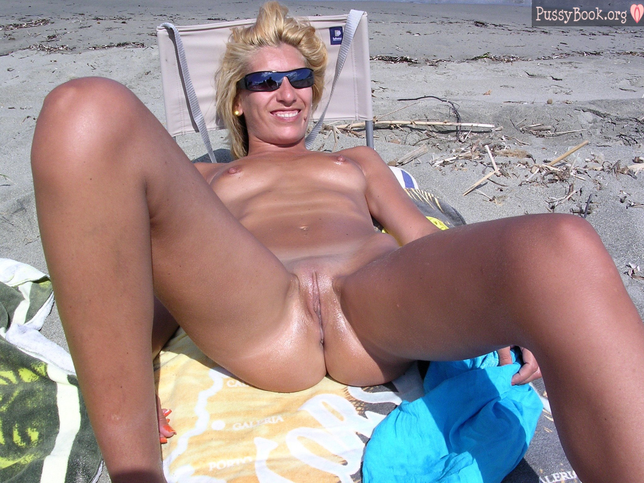 Nudist-Wife-Spreading-Legs-On-The-Beach  Pussy Pictures -6589
