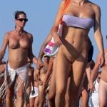 Nudists Marching on Beach