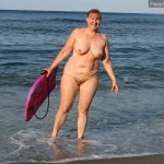 Older Nudist Woman on Beach