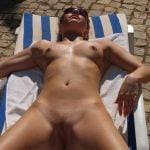 Real Amateur Nude Woman tanning on chair voyeur