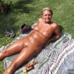 Shiny Nudist Granny Sunbathing