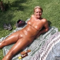 shiny-nudist-granny-sunbathing