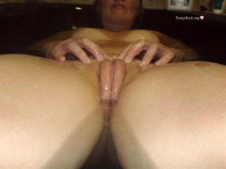 stretching-vulva-lips-in-bathtub