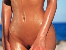 tanned-nude-curvy-body-natural-tits-on-the-beach
