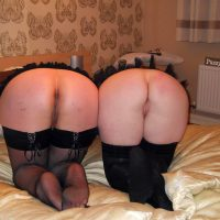 two-women-butts-bent-over