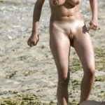 Voyeur Naked Girl on the beach looking at pussy