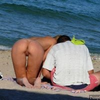 voyeur-spying-nude-woman-on-beach