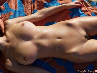wet-pleasent-naked-female-tans-on-sun