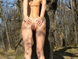 young-slim-babe-spreading-ass-in-forest